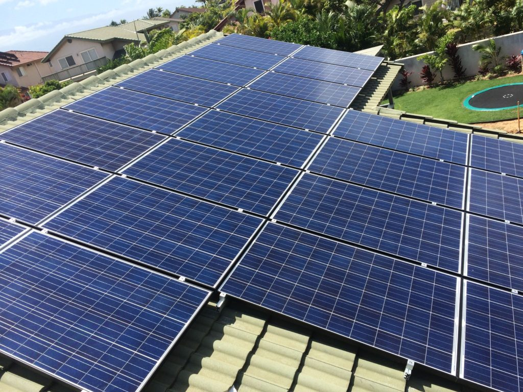 Cleaning solar panels on Maui